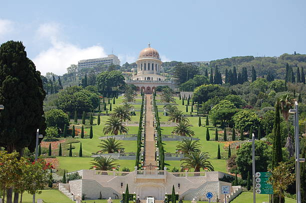 """""""Bahai Gardens in Haifa, Israel.  The gold domed Shrine of the Bab is visibile at the top of the image, with many terraces and steps below it."""""""